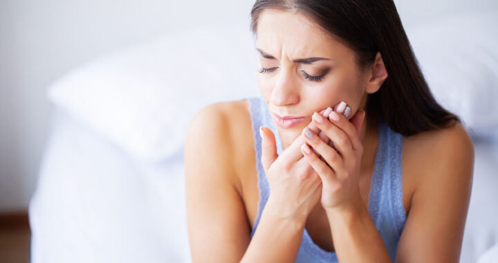 Woman Feeling Tooth Pain